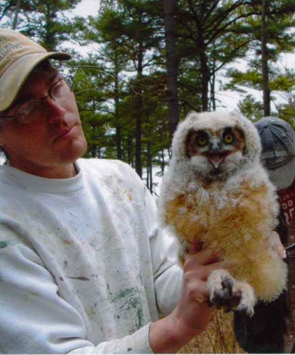 Jared Parks with juvenile great horned owl.