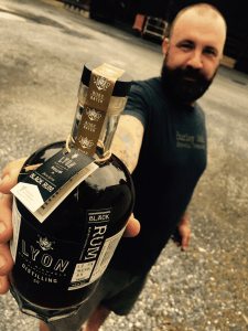 Patrick holding Black Rum